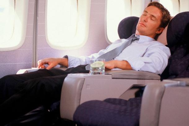 Businessman Sleeping in an Airplane